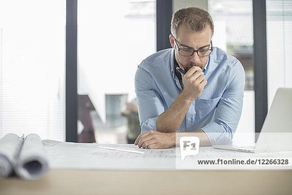 Man thinking about plan in office