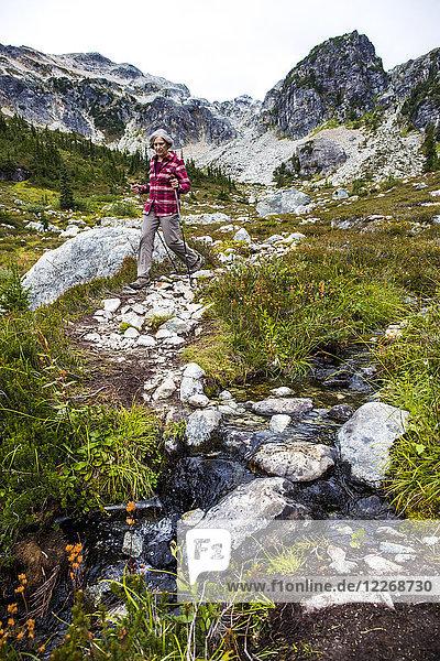 Woman hiking through Brandywine Meadows  Whistler  British Columbia  Canada