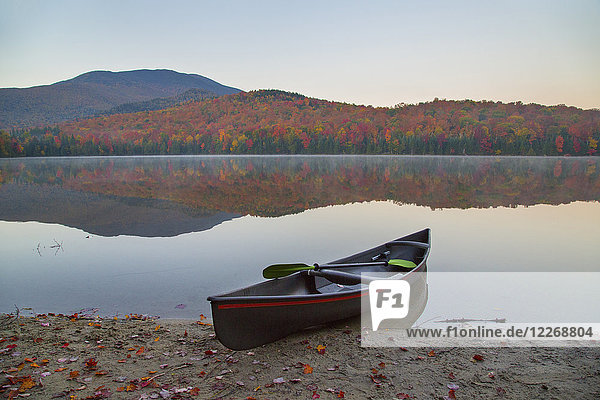 Canoe on shore of Heart Lake  New York State  USA