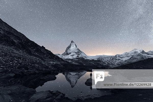 Matterhorn reflecting over Lake Riffelsee at night  Zermatt  Valais  Switzerland