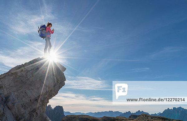 Hiker enjoying view  Dolomites near Cortina d'Ampezzo  Veneto  Italy