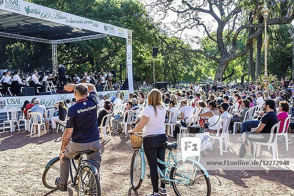 Argentina  Buenos Aires  Recoleta  Plaza Francia  park  Universidad del Salvador symphony orchestra free performance  audience  stage  outdoor  man  woman  bicycle  Hispanic  Argentinean Argentinian Argentine South America American