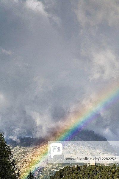 Rainbow and clouds over Tower Belvedere  Maloja Pass  Bregaglia Valley  Canton of Graubunden  Engadin  Switzerland.