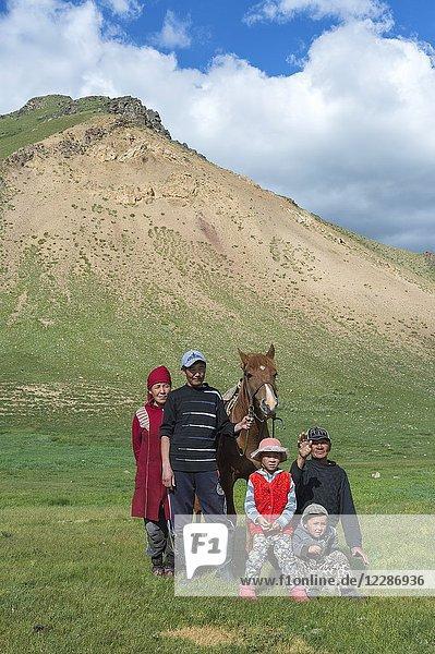 Kyrgyz family with horse  Sary Jaz valley  Issyk Kul region  Kyrgyzstan.