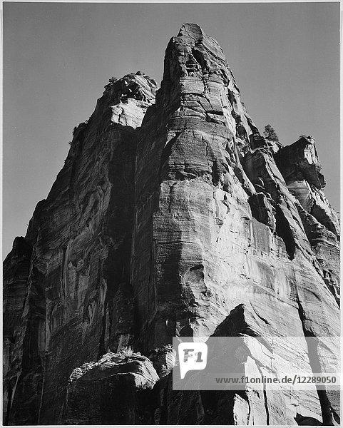 Rock formation from below In Zion National Park Utah. (Vertical orientation) 1933 - 1942
