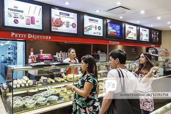 Argentina  Buenos Aires  Galerias Pacifico mall  shopping  food court  Brioche Doree  sandwich shop  French  petit dejeuner  breakfast  counter  man  woman  ordering food  Hispanic  Argentinean Argentinian Argentine South America American