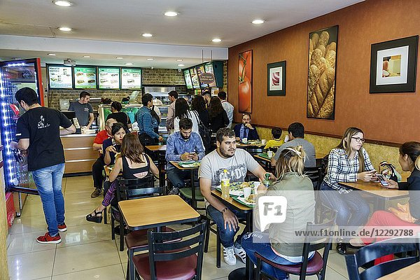 Argentina  Buenos Aires  Retiro  Subway sandwiches  restaurant  counter  tables  man  woman  customer  fast food  interior  Hispanic  Argentinean Argentinian Argentine South America American