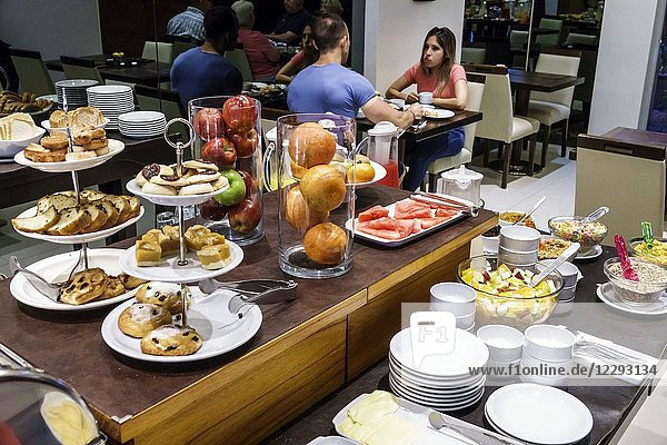 Argentina  Buenos Aires  Howard Johnson Hotel Boutique Recoleta  hotel  free breakfast buffet  pastries  fruit  man  woman  couple  Hispanic  Argentinean Argentinian Argentine South America American
