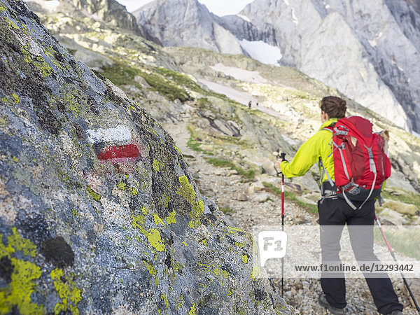 Woman hiking in the High Pyrenees ascending to mount Vignemale  Cauterets  France