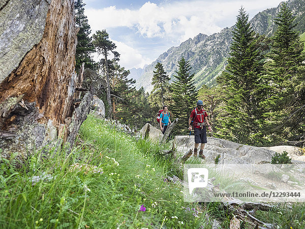 Man and woman hiking in the High Pyrenees near Cauterets  France