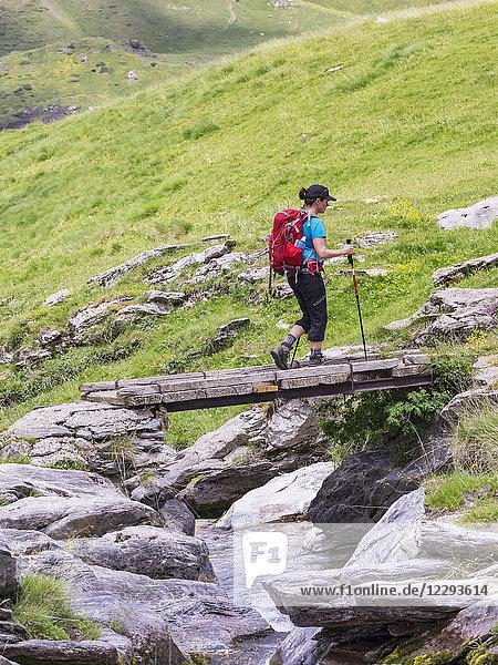 Woman hiker crossing wooden bridge  Gavarnie  France