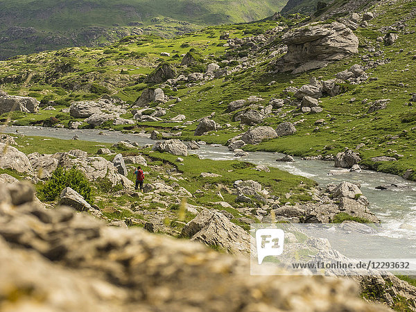 Woman hiking in the High Pyrenees near Pont d'Estaube  France