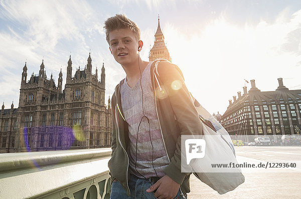 Portrait of boy in front of city buildings  London