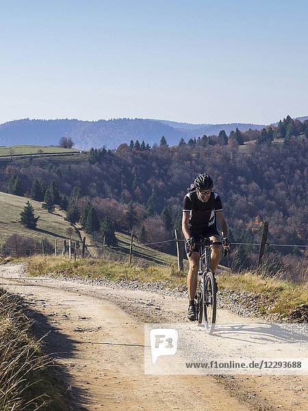 Cyclocross rider on cycling tour near Grand Ballon  Vosges  France
