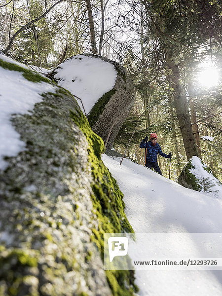 Low angle view of a Girl snowshoeing in Black Forest  Germany  Europe