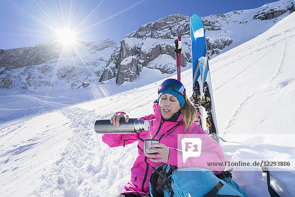 Woman skier on hot teak break