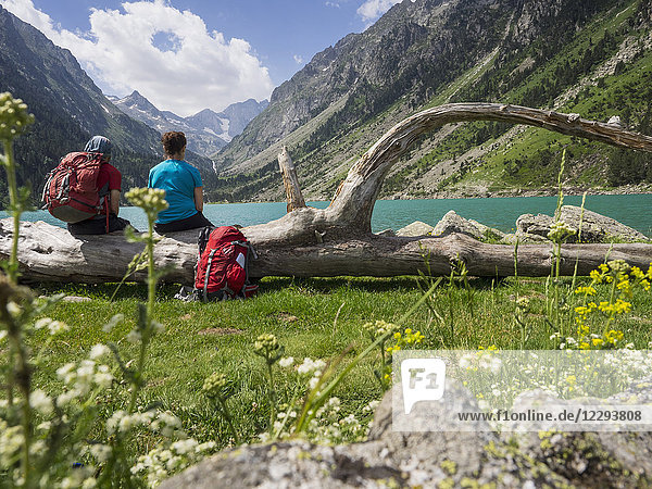 Hikers admiring scenic view of mountain and Gaube Lake  Cauterets  France