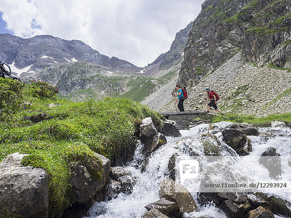 Man and woman hiking in the High Pyrenees  Cauterets  France