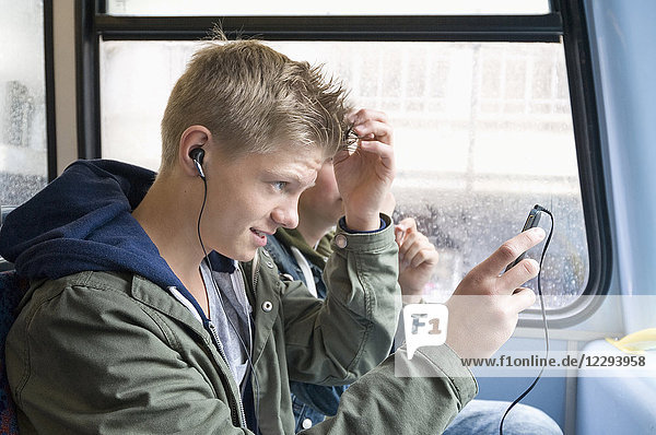 Boy tunes up his hair in public bus  London
