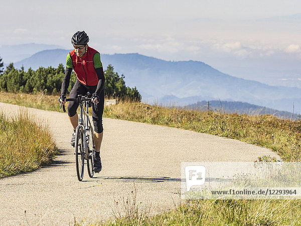 Man riding racing bicycle on cycling tour in the Northern Black Forest  Germany