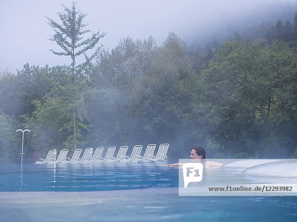 Woman relaxing in swimming pool of Paracelsus-Therme  Bad Liebenzell  Baden-Württemberg  Germany