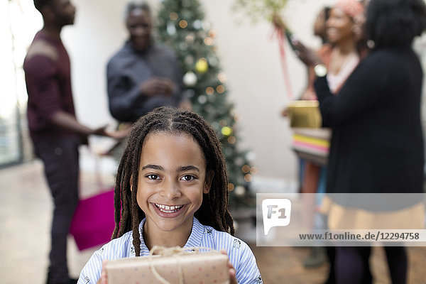 Portrait smiling girl with Christmas gift