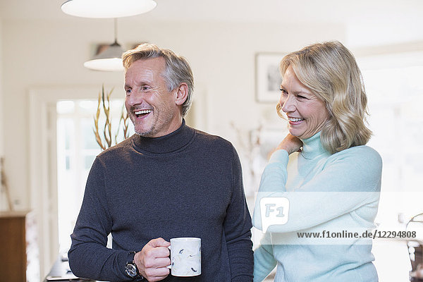Laughing mature couple drinking tea