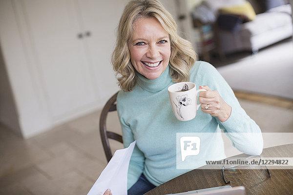 Portrait smiling  confident mature woman drinking tea