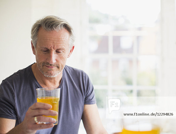 Mature man drinking juice