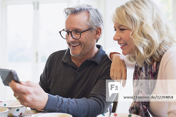 Mature couple taking selfie with smart phone