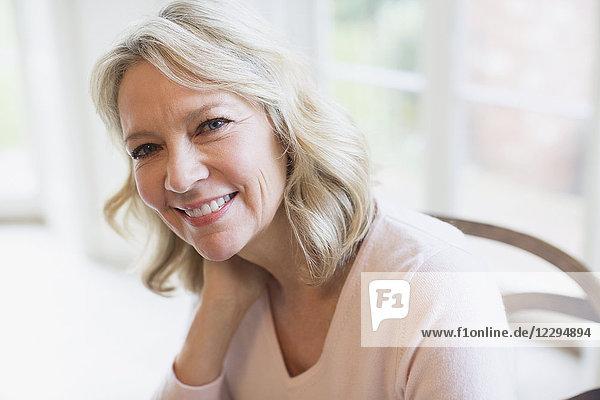 Portrait confident  smiling mature woman