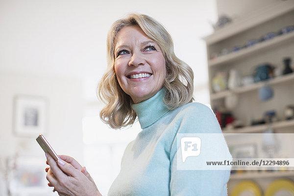 Portrait smiling  confident mature woman texting with smart phone