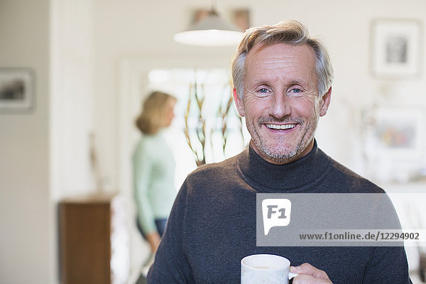 Portrait smiling  confident mature man drinking tea