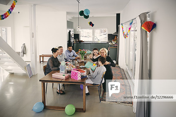 High angle view of family enjoying birthday party at home