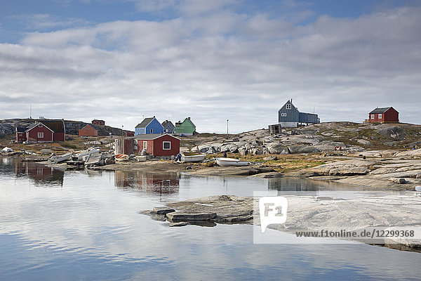 Remote fishing village at craggy waterfront  Kalaallisut  Greenland