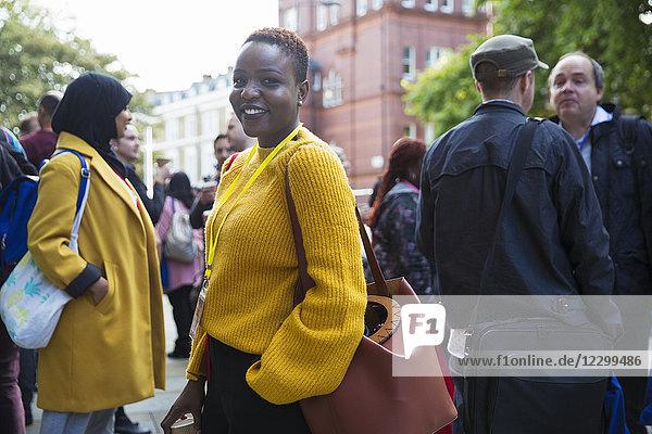 Portrait smiling  confident businesswoman in crowd