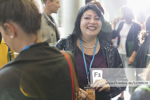 Portrait smiling  enthusiastic woman at conference