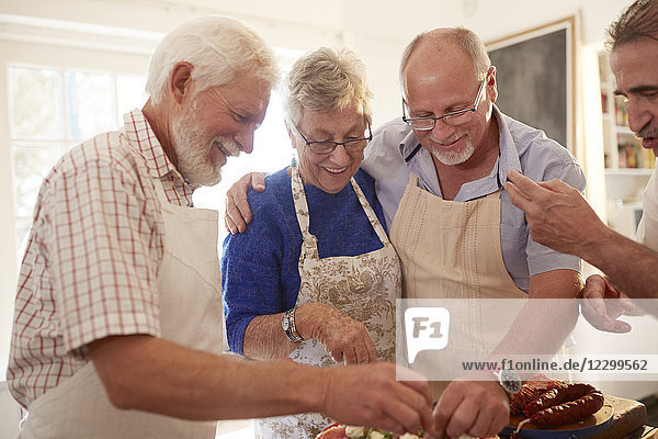 Senior friends enjoying cooking class