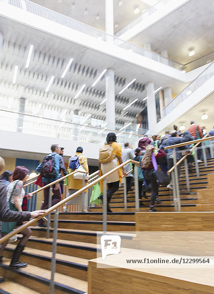 Business people ascending stairs