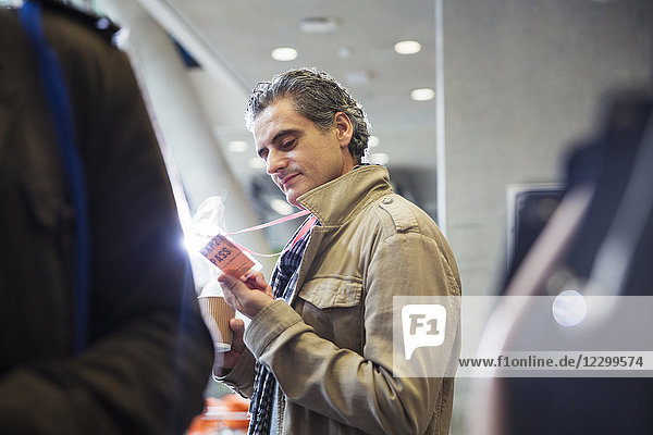 Businessman looking at conference identification pass Businessman looking at conference identification pass