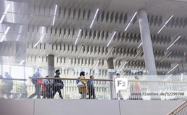 Business people walking on modern office balcony