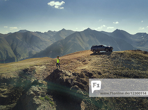 Woman looking at view of tundra in mountains  Silverton  Colorado  USA
