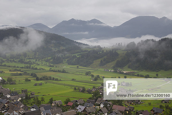 Cloudy weather covering mountains in fog  Bohinj valley in Julian Alps  Slovenia