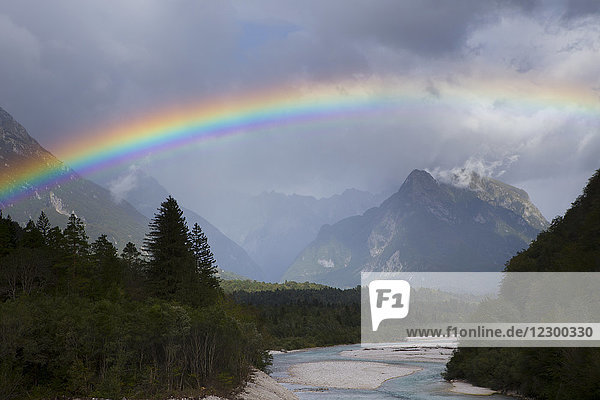 Majestic view of rainbow over Soca River with mountains in background near Bovec  Slovene Littoral  Slovenia