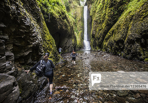 A woman hiking in the Ononta falls gorge in the Columbia Gorge area of Oregon.