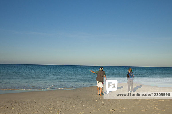 Rear view of couple at beach of Geographe Bay  Cape Naturaliste  Western Australia