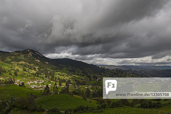 Majestic view with dramatic sky over Mindo village in Andes Mountains  Pichincha Province  Ecuador