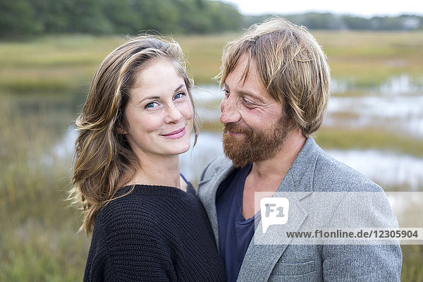 Portrait of smiling couple in natural setting