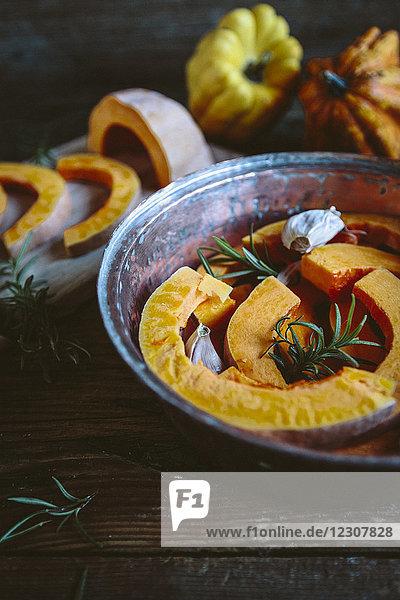 Pumpkin slices  garlic and rosemary in casserolle