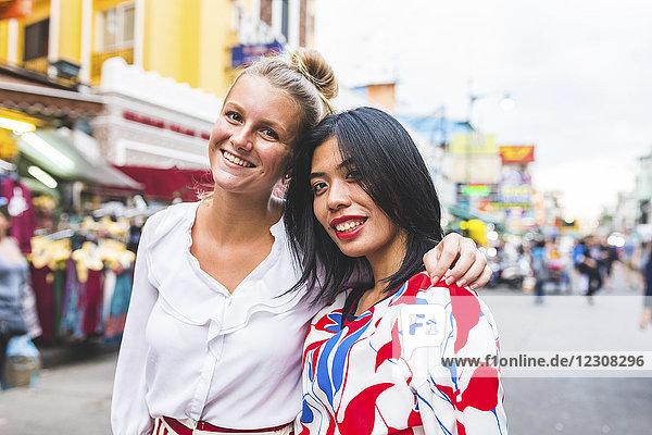 Thailand  Bangkok  Khao San Road  portrait of two happy friends